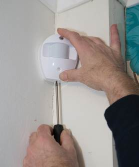 Alarm Sensor being Installed in a Leicester Home